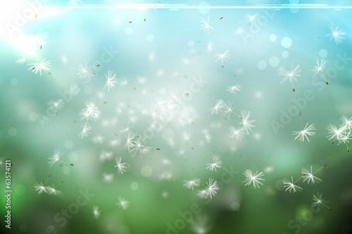 Digitally generated dandelion seeds on green background
