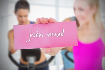 Fit blonde holding card saying join now