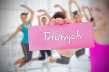 Fit blonde holding card saying triumph