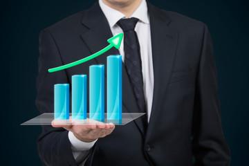 Businessman holding a chart
