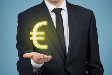 Busenessman holding Euro sign