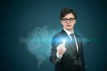 A businessman pointing out to the hologram map
