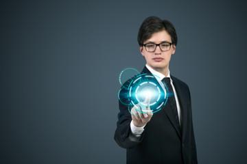 A businessman pushing the digital button