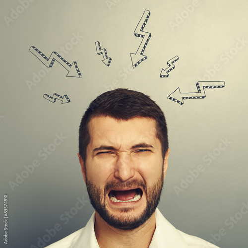 crying man over grey background