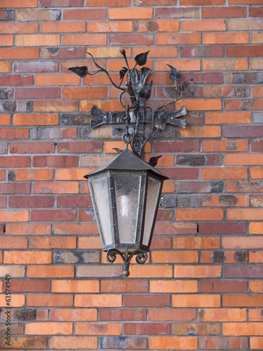 Lamp on a wall of a facade of the building