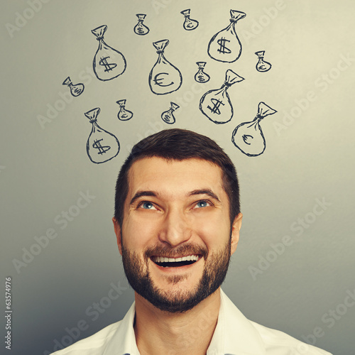 man looking up at moneybags
