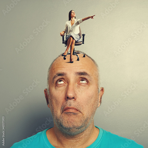 woman pointing and sitting on amazed man