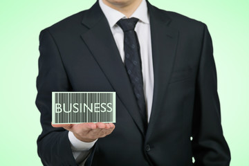 Businessman holding a card with the word 'business'