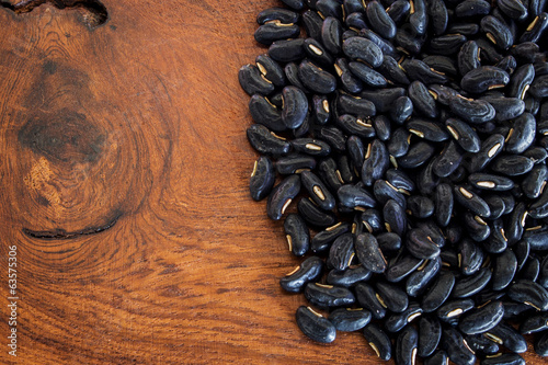 close up bean black seed on wood table