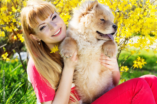 Girl with her dog on the nature