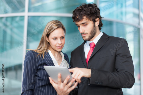Business people using a digital tablet