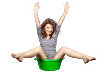 Funny girl sitting in a basin.
