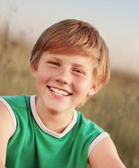 Smiling boy outdoors portrait