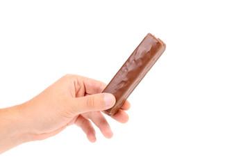 Hand holds tasty chocolate.