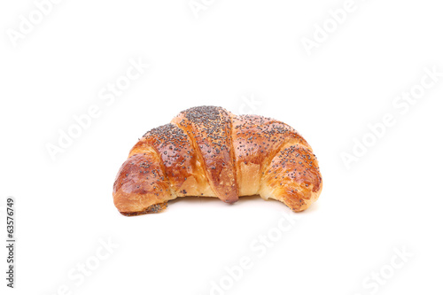 Appetizing croissant with poppy.