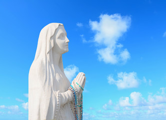 statue under clouds