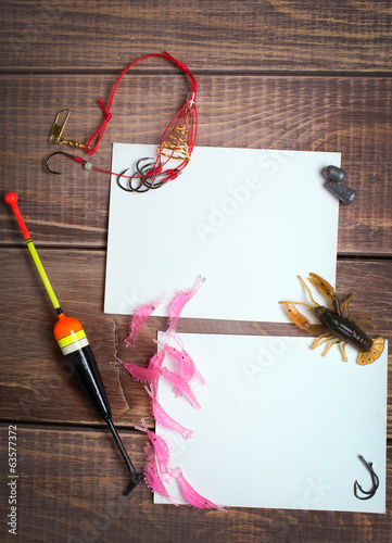 fishing gear on wooden boards with empty place