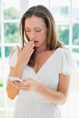 Shocked woman reading text message