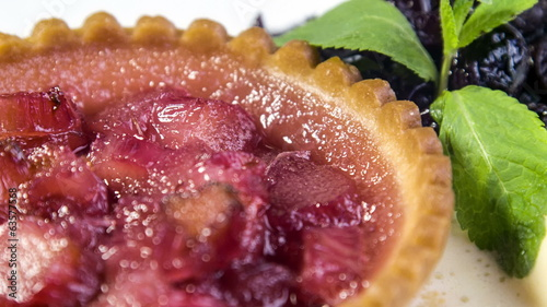 Freshly baked rhubarb tartlet with honey ice cream