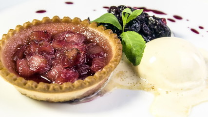 Freshly baked rhubarb tartlet  honey ice cream , cherry coulis