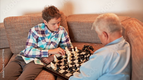 Castling, The Game of Chess, Teen and Grandpa Playing Chess