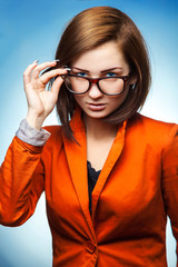 Cute business woman with glasses and jacket