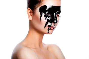 Horizontal photo of beauty woman with black paint on face