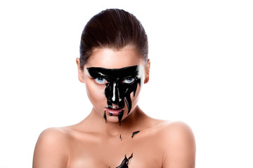 Portrait of sensual woman with black paint on face