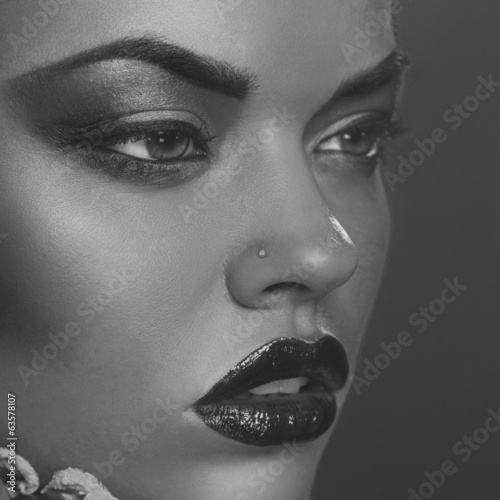 Desaturated close up portrait of beautiful woman