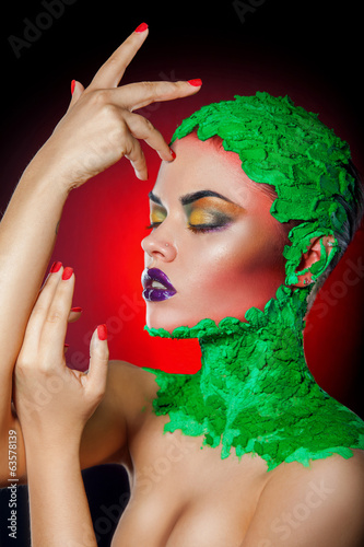 Gorgeous portrait of woman with creative makeup