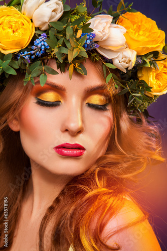 Sensual girl with wreath on hair