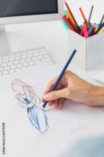 Extreme closeup of a fashion designer working on designs