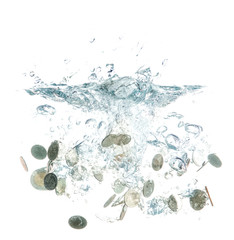 coins falling into the clear water