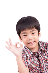 smiling boy showing ok sign