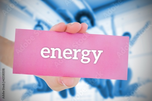 Woman holding pink card saying energy