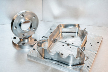 Metal mold and steel flanges. Milling industry. CNC technology.