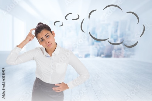 Composite image of worried businesswoman with speech bubble