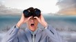 Image of suprised businessman looking through binoculars