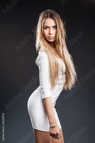 blonde model with lovely long hair and a curvaceous body posing