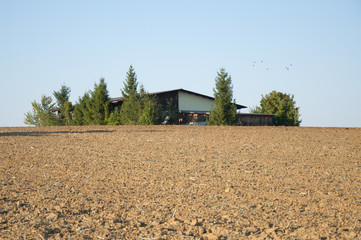Ploughed Land Besides a House in the German Countryside