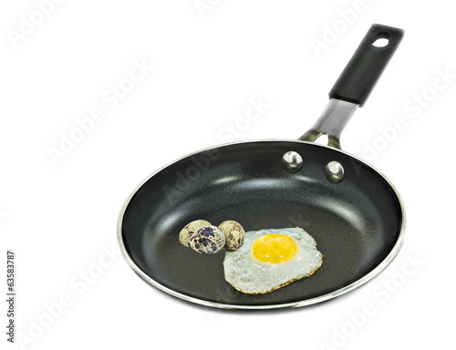 Frying pan with eggs isolated on white background