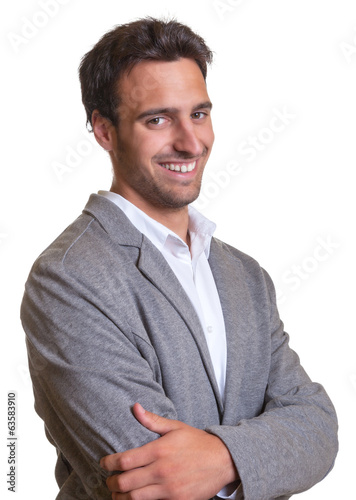 Standing latin businessman in grey suite with crossed arms