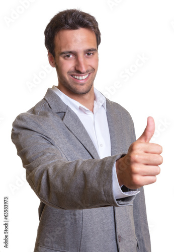 Latin businessman in grey suit showing thumb up