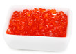 Red caviar in white bowl isolated on white