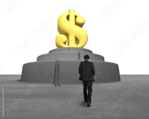 Businessman walking toward large money symbol