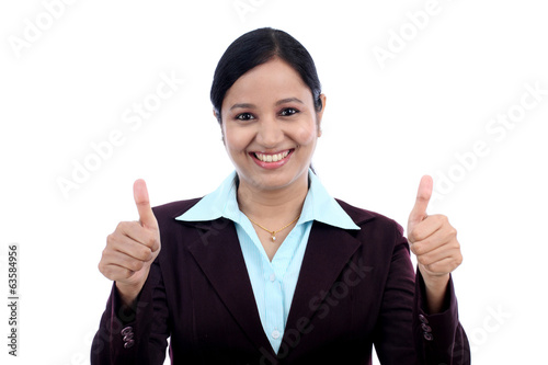 Young business woman with thumbs up gesture