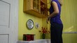 girl prioritizes jars the cupboard with canned vegetables