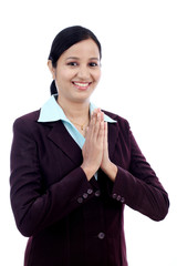 "Young Indian business woman greeting ""Namasthe"""