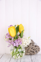 Flowers in vase with decorative heart