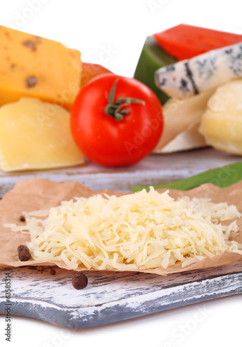 Different Italian cheese on wooden board, close-up